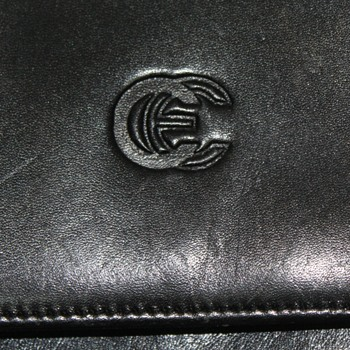 Does anyone know the company with this logo?  It's a black leather purse. - Bags