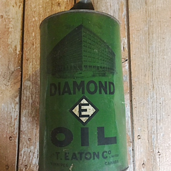 This one is a mystery!  Diamond E Oil, with T.Eaton Co. Winnipeg.  Did Eatons sell oil?   - Petroliana