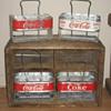 A Few Aluminum Coca-Cola Carriers