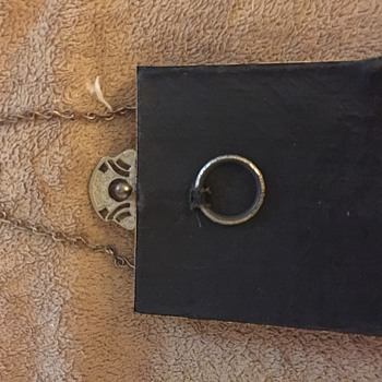 Antique black coin purse with brass frame, chain, ring, and clasp