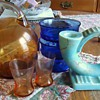 Eng. candle holder, cobalt blue dishes, and orange pitcher and glasses?
