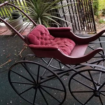 Antique reproduction baby buggy
