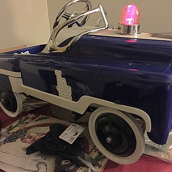 restored police pedal to Dodgers themed pedal car.