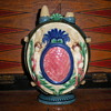 19th century majolica baby feeder with 4 fairies