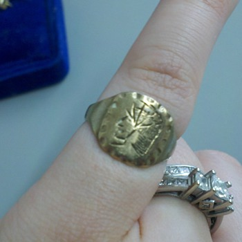 ring found we know its real gold..value???