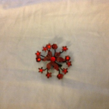 Red flower brooch signed Austria