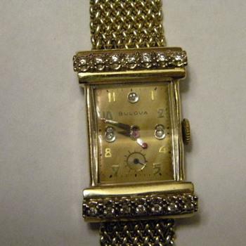 1947, 14k gold case, 14 diamonds