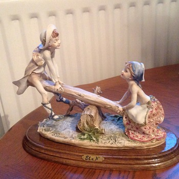 Stoneware figurine of boy and girl