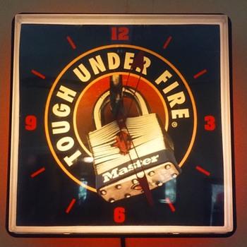 MASTER PADLOCK 'TOUGH UNDER FIRE'  illuminated clock - Advertising