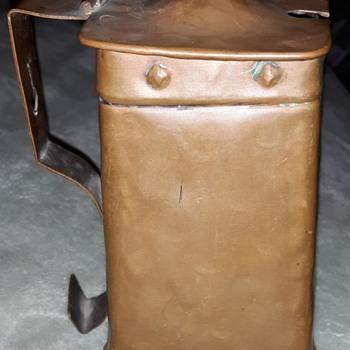 It is a  Cape Cod Shop Copper Fire Starter Pot - Kitchen