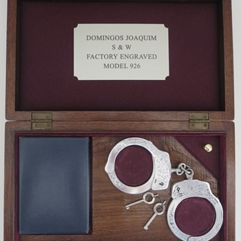 Factory Engraved S&W Handcuffs - Politics