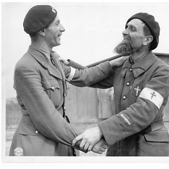 WWII Belgian Chaplain & French Chaplain congratulating each other on being liberated from Nazi POW Camp by U.S. Army, 1945 - Military and Wartime
