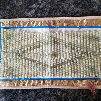 Oriental rug?  With jade beads.