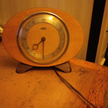 Metamec made in Dereham UK, Oval or Rugby shaped electric clock wood and metal.