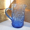 Molded Glass Water Pitcher with fruit pattern and applied handle