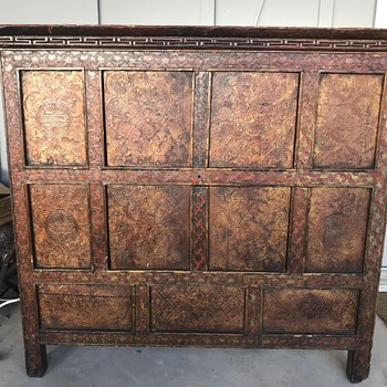 Very old cabinet with metal relief.  - Furniture