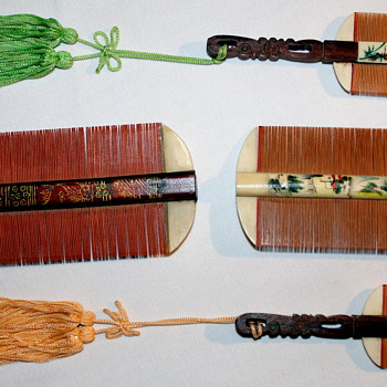 Asian Combs? Handpainted wood with bone?