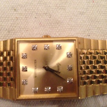 Wittnauer Quartz gold and diamond watch.