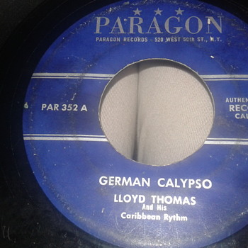"LLOYD THOMAS And His Caribbean Rythm PARAGON RECORDS 45 RPM ""GERMAN CALYPSO"" / ""COLD IN DE WINTER"" - Records"
