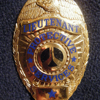 ROCKWELL  INT'L PROTECTIVE SERVICES ENTENMANN-ROVIN HM'ED BADGE - Medals Pins and Badges