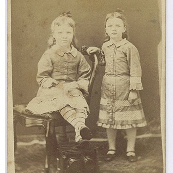 CDV of two sisters using a stereo camera as a footrest - Cameras