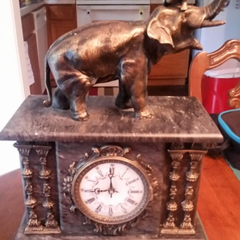 A beautiful marble with bronze elephant and trumpeter mantel clock
