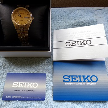 2014-seiko gold plated mens solar powered watch.