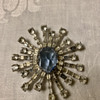 Weiss signed radiant design brooch with irregular cut blue center stone and clear rhinestones