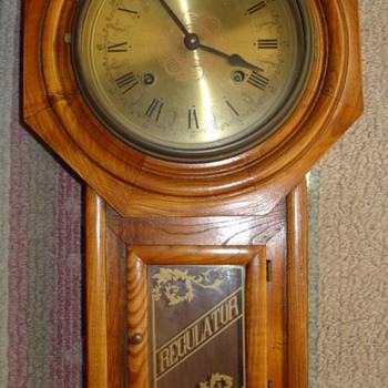 Antique Regulator  oak wall clock, brass surface, engraved flower  - Clocks