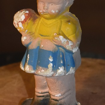 Little Chalkware Girl with Flowers - Pottery