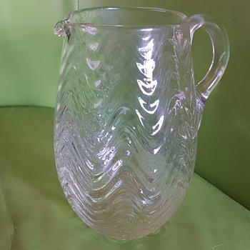 Swagger or wave patterned glass jug