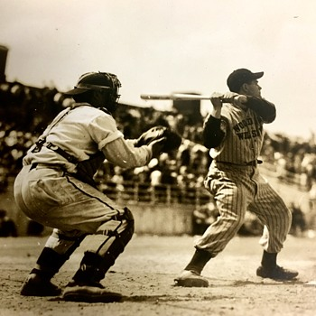 found this photo cleaning out a house , need help to identify the player and if its authentic  - Baseball