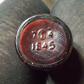 Medicine bottles (2) showing bottom stamped date on each