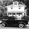 My house built in 1928 and my 1937 Chevrolet truck in black and white
