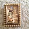 Romeo and Juliet bakelite/ivory brooch