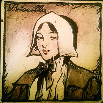 Art tile or wall hanging with Priscilla (Alden?) copyright 1929 - Pottery