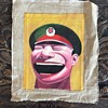 similar to the works of Yue Minjun it looks like one of his smiling face portraits, it has been in a frame, what do you think