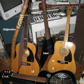 A group of  guitars and stuff.