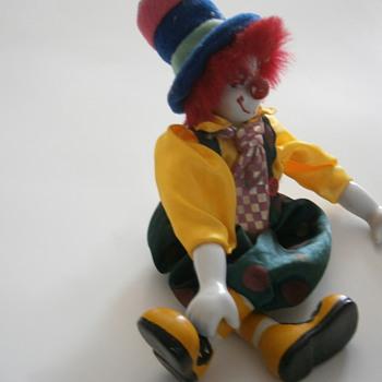 Porcelain sitting Dangling Clown Doll - Dolls