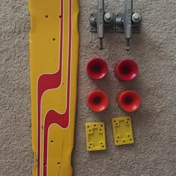 Rare Fiberglass Skateboard with wheels, trucks and riser pads