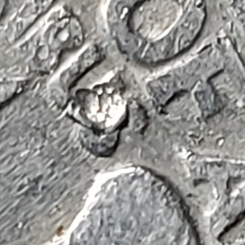 2 1980 Quarters that have doubling in the lettering and these weird things what is it? - US Coins