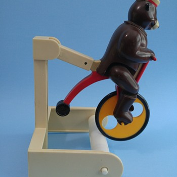 Bear on bicycle toilet paper holder