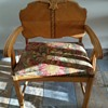 Wide wood chair with grooved armrest cushion seated engraved