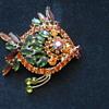 Multicolored glass fish brooch