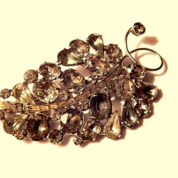 Perhaps a gray and clear rhinestone brooch bunch of grapes? - Costume Jewelry