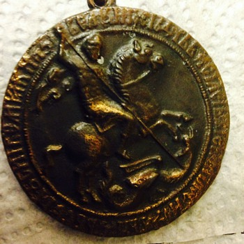 medallion with a woman on the other side