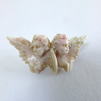 Antique carved angels coral brooch