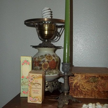 Antique Sewing Machine with Jewelry Boxes, Avon Cologne Bottles, and Lamp and Candlestick - Lamps