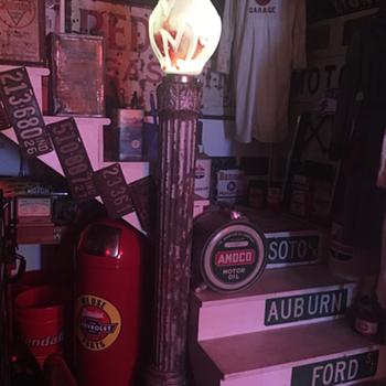 Repurposing the 5' cast iron fluted pole to hold a Standard Oil glass globe flame  - Petroliana