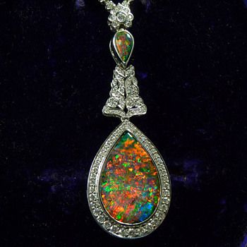 AURORA - an Antique 20ct Gem Quality Solid Black Opal from Lightning Ridge, set in a Modern White Gold and Diamond Necklace